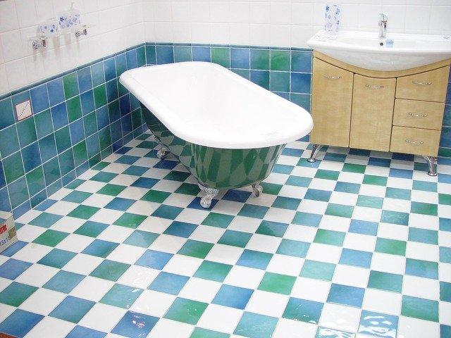 Central Drain System in walk-in bathroom shower