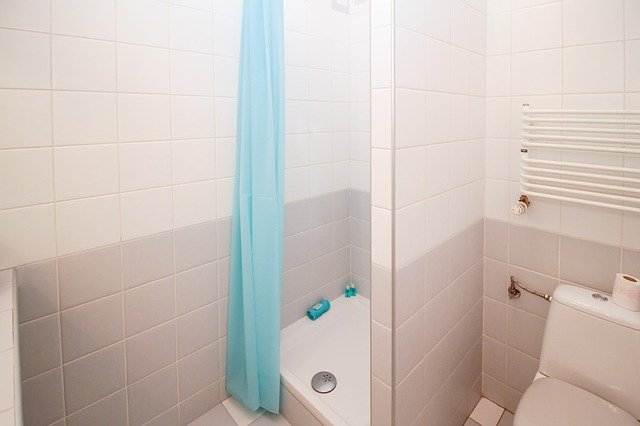 Claw-Foot Shower Pan in small bathroom